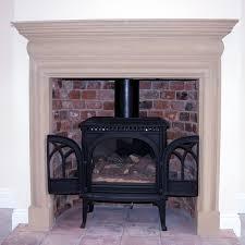 stone fireplace surround with wood burner