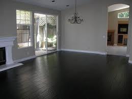 dark laminate flooring with grey walls