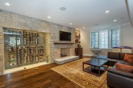 wine cellar glass door family room contemporary with dark wood coffee table wood floor wine rack