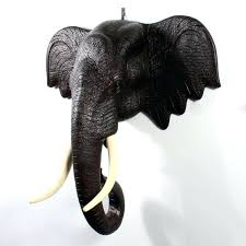 elephant head wall mount a pair of huge carved elephant heads with curled trunks and painted elephant head wall mount