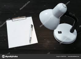 Copy Of A Blank Resume Blank Paper Page Document Copy Space Lamp Black Office Table