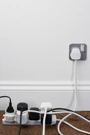 Hide electrical cords behind furniture or curtains, or elevate them to keep  them out of