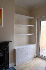 alcove cabinet and floating shelves
