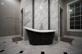 bathroom accent wall using super white marble to tie the countertops and room together