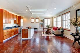 Large Whiskey Wooden Kitchen With A Soft Colors Dining Area And