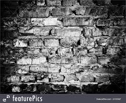 Texture: Old collapsing brick wall. The black and white image.