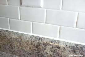 tile backsplash edge caulk white subway tile tutorial subway tile kitchen backsplash edges
