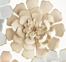 white and pink metal flower wall art