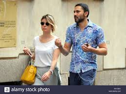 Milan, Euridice Axen walks in the center with a friend Euridice Axen,  daughter of the Swedish actress Eva Axen and actor Adalberto Maria Merli,  who however did not recognize her as a