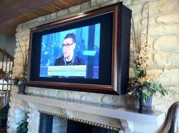 framed tv over fireplace