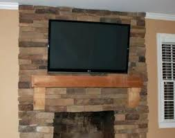 tv and fireplace wall impressive fireplace wall mount blogs within mounting a over a fireplace popular