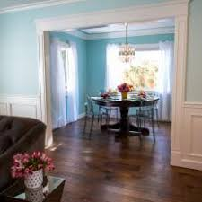 turquoise dining room with ghost chairs