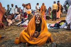 photo essay evocative pictures of the kumbh mela a sadhu prays as he sits on the banks of sangam