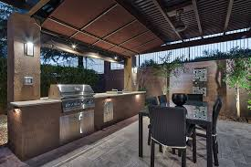 this outdoor kitchen and dining room offer abundant prep space with the natural stone work surface