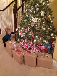 fake present barricade ie wrapped diaper bo filled with books prevents baby from getting under the tree i put it far enough out that he can
