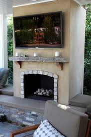 outdoor fireplace with tv ideas 6b8a9a7aeb c59c4973cd7f6ab stucco fireplace fireplace design