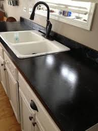DIY: Countertop Makeover Tutorial - this blogger takes the intimidation out  of refacing laminate.