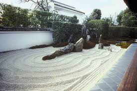 rocks and sand suggest a yin and yang like contrast in japanese garden design
