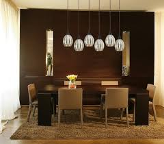 enchanting pendant lamps as modern dining room light fixture which is covered by glass cover above hardwood dining table and yellow flowers