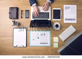 designer office desk isolated objects top view. businessman working on a laptop at office desk with paperwork and other objects around top designer isolated view f