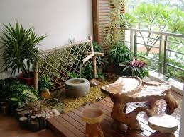 garden landscaping: Appealing Small Balcony Garden View Which Is Enhanced  With Captivating Oak Table And