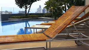 wooden teak lounge chairs patio stock