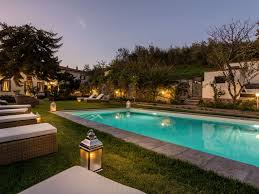 swimming pool farmhouse lighting fixtures. Capannori Farmhouse Rental - The Garden And Pool Area Swimming Lighting Fixtures O