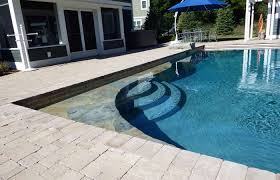 swimming pool designs medium size cascade pool with natural stone detail retaining walls and firepit sheer