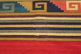 before and after photos of hole in rug repaired on mexican zapotec flat weave sedona az