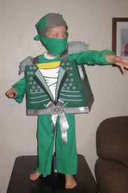 Home Made Ninjago Halloween Costume: Lloyd the Green Ninja. Cardboard  shaped and held together with duct tape on the inside, then outside spray  painted…