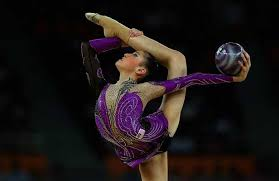 elaine koon of msia performs with the ball as she petes in the in the all around rhythmic gymnastics