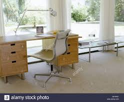 home office light. Modern Home Office With A Light Wood Desk And Swivel Chair In Front Of Large Sunny Windows To Back Garden I