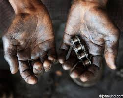 hands holding greasy roller chain parts