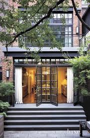 amazing patio features transom windows over folding glass doors