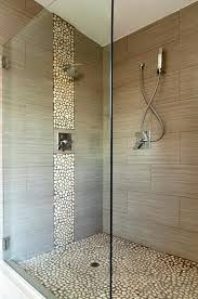 bathroom i would replace the pebbles with blue glass tile to give a waterfall feel