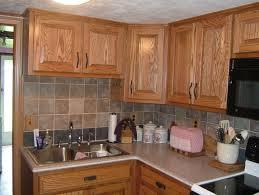 best corian countertop with tile backsplash and kitchen sink faucets plus paint kitchen cabinets for elegant kitchen design