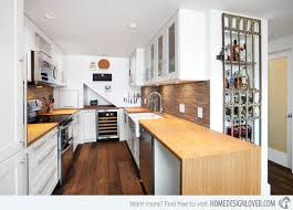 small u shaped kitchen design: white cabinet  shaughnessy condo white cabinet