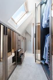 attic closet with drawers and a wardrobe