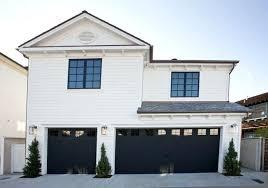 black garage doors great black garage doors white house remodel with black garage doors white house