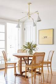 achieving the effortless expensive style furniture emily henderson find this pin and more on dining rooms