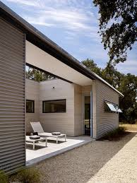 above in sonoma schwartz and schwartz architecture wrapped the facade of a 500 square foot pool house in corrugated metal siding