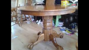 round dining table carved lion shape extendable solid oak 105 150cm