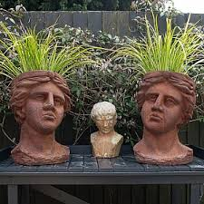 rusted clical head outdoor planters set of 2