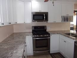 Kitchens With White Appliances Custom Kitchen White Cabinetry With Granite Countertop Also Panel