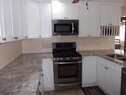 Kitchen Remodel Granite Countertops Custom Kitchen White Cabinetry With Granite Countertop Also Panel