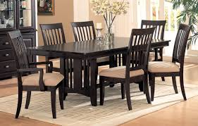 black polished oak wood dining chair with lath backrest and light brown padded seat combined with