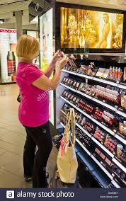 woman traveller ping for duty free free cosmetics make up beauty s perfume in an airport