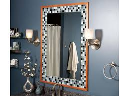 friendly bathroom makeovers ideas: a tile or wood frame adds style to a plain mirror any tile will work we used a mosaic glass tile apply the tile to the wall using mastic adhesive