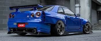 Nissan r34 skyline with large widebody fender flare kit. Widebody R34 Nissan Gt R Is Full Of Carbon Looks Sliced Autoevolution