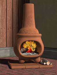 orange clay chiminea with leaves ornaments for patio heater ideas